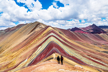 Poster Tourists couple stand and look afar at Rainbow Mountains, Cusco, Peru