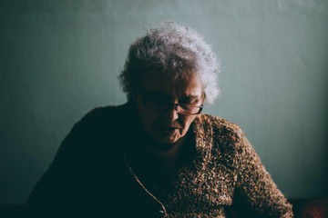 Old Woman in Pain Making Strong Facial Expressions