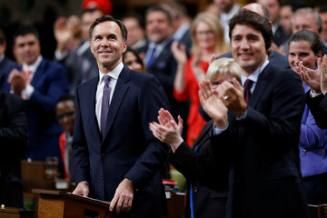 Canada's Finance Minister Bill Morneau receives a standing ovation before delivering the Fall Economic Statement in Ottawa