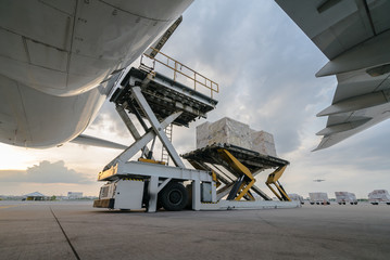 Loading cargo plane outside air freight logistic Wall mural