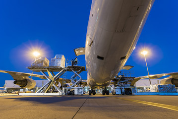Business of air cargo freighter with import and export at twilight sky Wall mural