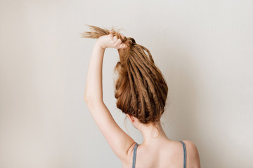 Ginger woman with dreadlocks. Interesting hairstyle