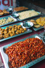 Fried prawns and other indian delicacies on sale at a food stall.