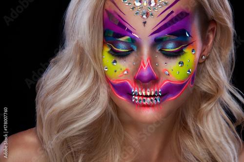 beautiful blonde model woman witn santa muerte makeup sugar skull for day of the dead