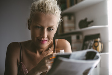 Caucasian Woman Reading a Magazine While Having Breakfast