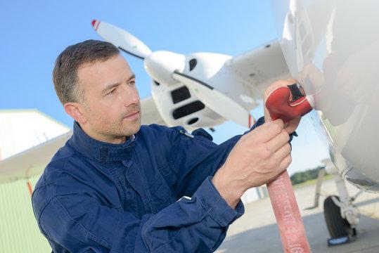 Mechanic beside aircraft