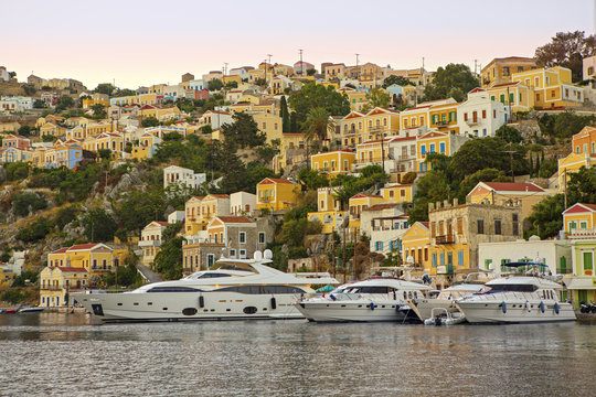 Yachts docked at harbour of Greek island Symi