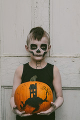 Little boy with skeleton make up for halloween