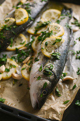 Sea bass with lemon and spices ready to be grilled