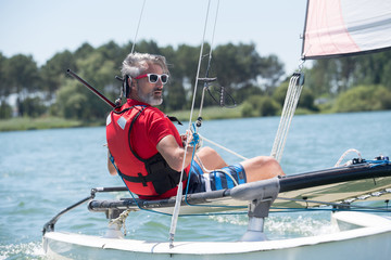 Photo Blinds Water Motor sports man sitting on a sailboat