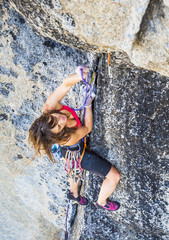 Female climber determined to succeed.