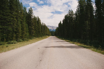 A deserted road with mountain views in Banff National Park