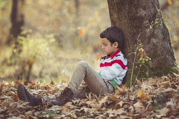 Child sitting in forest