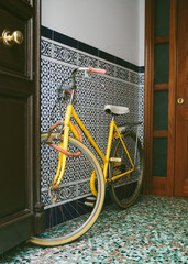 Old yellow bicycle.