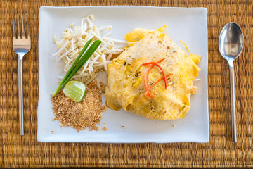 """""""Pad thai"""" noodle stir with dried shrimp and thai sauce style serve with side dishes include bean sprouts and garlic chives"""