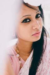 beautiful young woman wearing pink