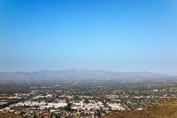 West side of Valley of the Sun looking at Glendale, Peoria and Phoenix as seen from North Mountain Park, Arizona. Copy space.
