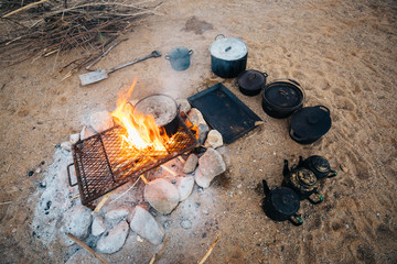 Outdoor camp fire cooking in the desert