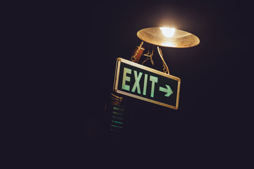 Exit sign in the gloom