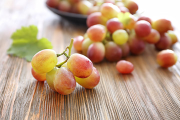 Fresh ripe grapes on wooden background
