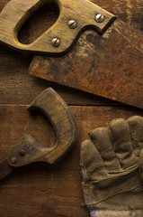 Rusty Saws and Work Glove