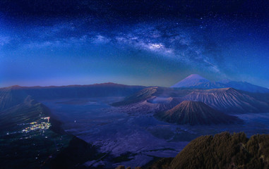 Landscape with Milky way galaxy over Mount Bromo volcano (Gunung Bromo) in Bromo Tengger Semeru National Park, East Java, Indonesia. Night sky with stars. Long exposure photograph.