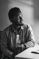 Portrait of black man on his office. Black and white photo.