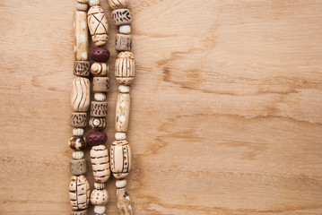 Tribal african beads from polymer clay fashion background on wooden table. Handmade jewelry.