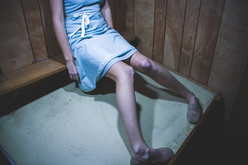 girl wearing a blue dress and knees touching