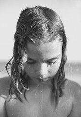 Close up portrait  of a little girl having a refreshing bath