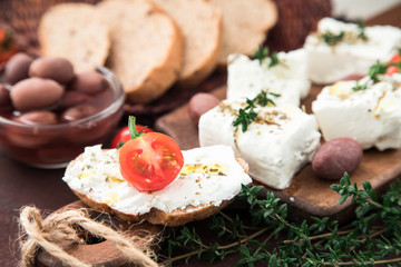 Greek cheese feta with thyme and olives.  selective focus, copy space