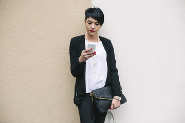 Real Italian businesswoman using a phone