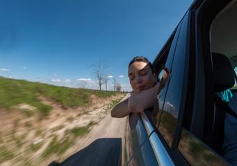 Woman enjoying car ride.