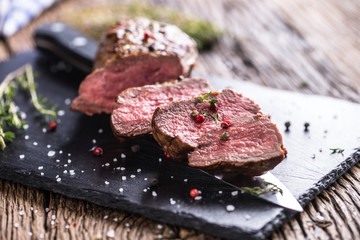 Beef Steak. Roasted Beef steak with salt pepper thyme on rustic wooden table