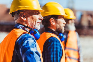 Obraz workers at construction site - fototapety do salonu