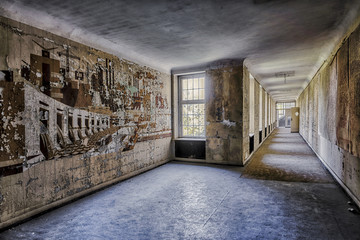 abandoned corridor with doors and large picture