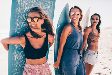 Group of young adult woman having fun at the beach Wall mural