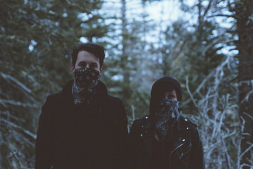 Couple wearing mask in woods