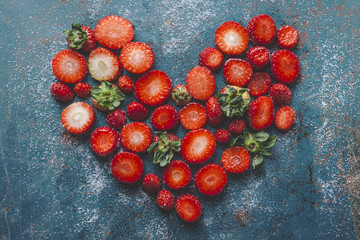 Strawberry heart on blue background.