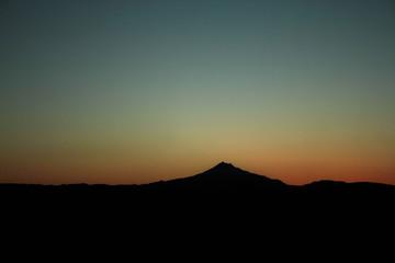 A Desert Mountain Sunset in Silhouette