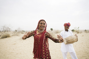 Rajasthani dancer and musician in Rajasthan desert. India.