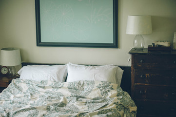 Blue and White Bed in a Bedroom