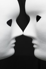 Two white masks, connection, abstract