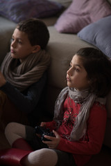 Children enjoying game console at home