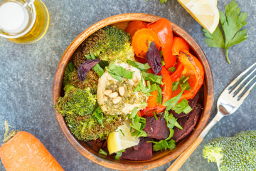 Vegetarian salad of baked vegetables with hummus