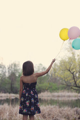 A Girl Outside With Balloons