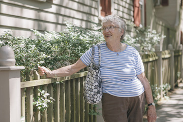 Portrait of a Senior Woman on Sidewalk of Residential Neighborhood