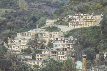 A village nestled on a mountainside