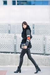 Stylish woman walking down the street