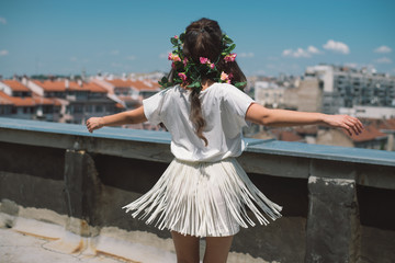 Hippie girl dancing on the rooftop